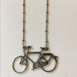 American Eagle long necklace with bicycle